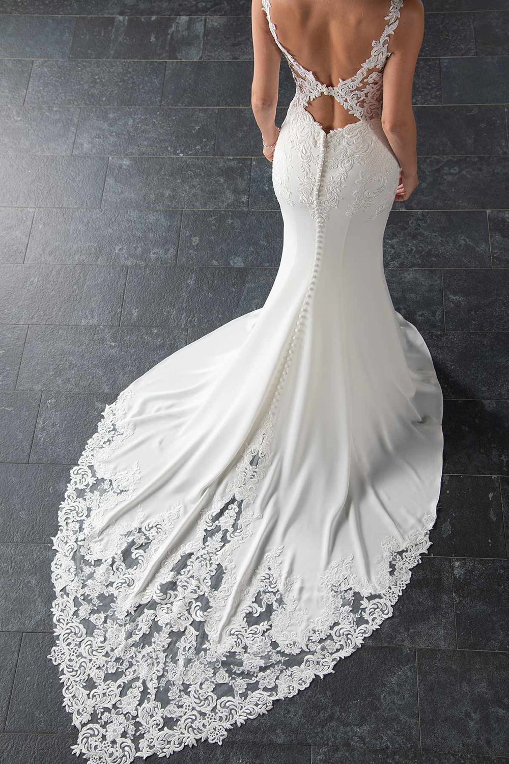 ac17996a313 This sexy wedding dress with sheer open back is a dream! A modern lace  pattern mixed with a sleek and chic crepe skirt creates one of the hottest  dresses in ...